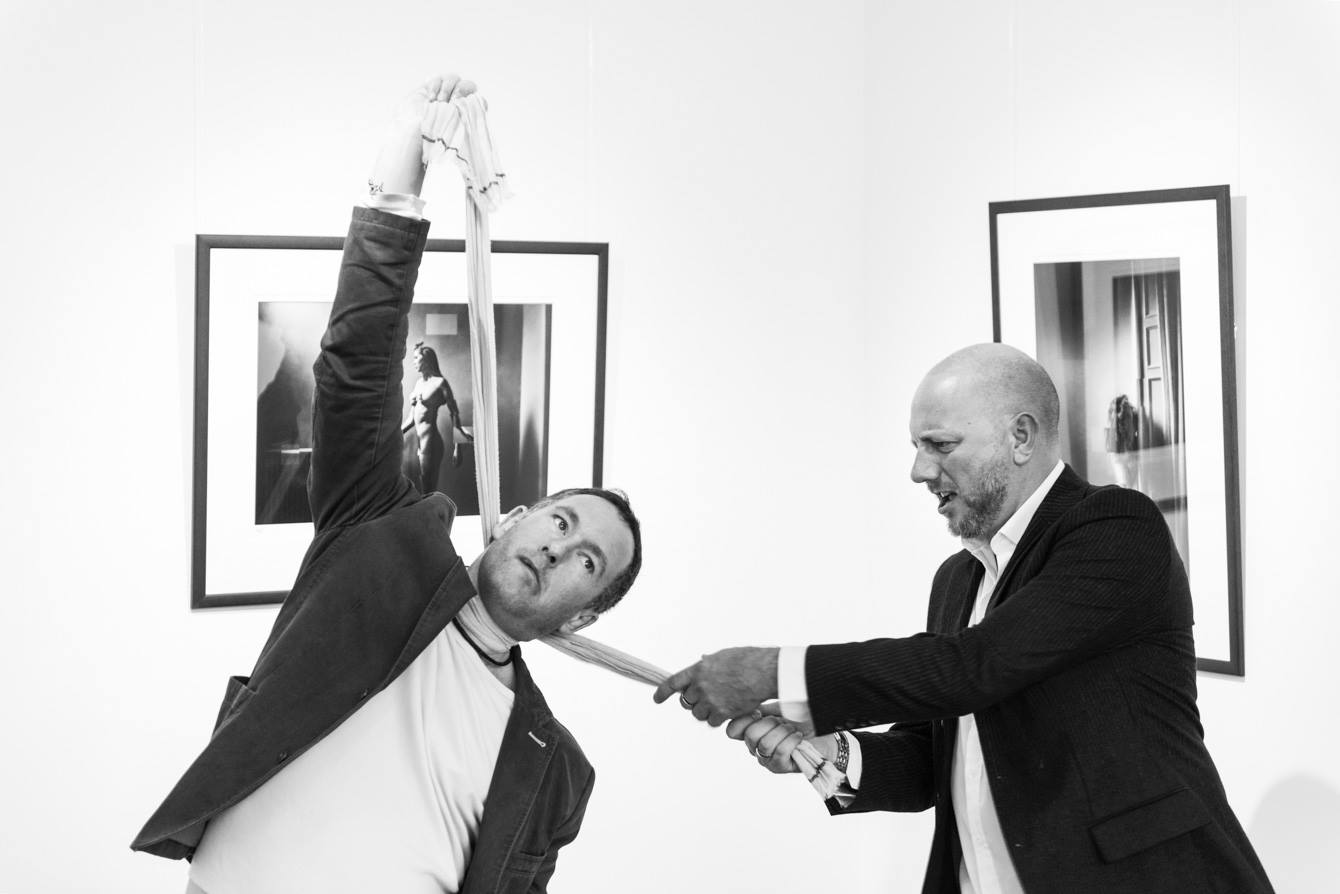 Paul Bock photographs Lee Howell and Chris Close at Urbane Art Gallery during the Retina Opening.